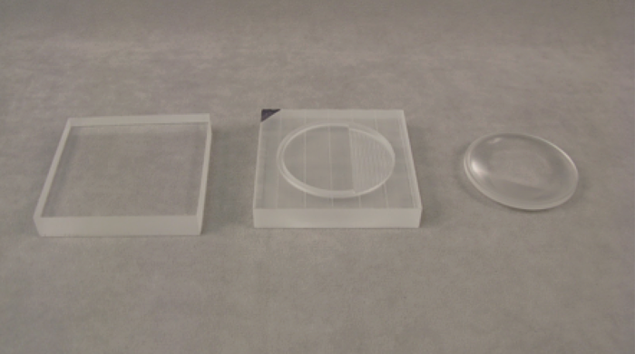 Acrylic Lens At Various Stages of the Machining Process