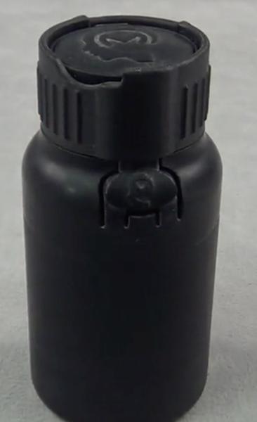 Four piece child safe bottle with novel living hinge opening mechanism